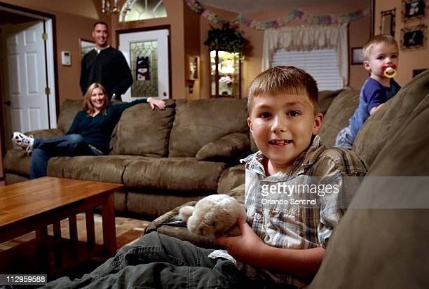 "Matthew Thibodeau holds his toy manatee, ""Whiskers,"" at his family's Oviedo home in Florida, November 27, 2006."