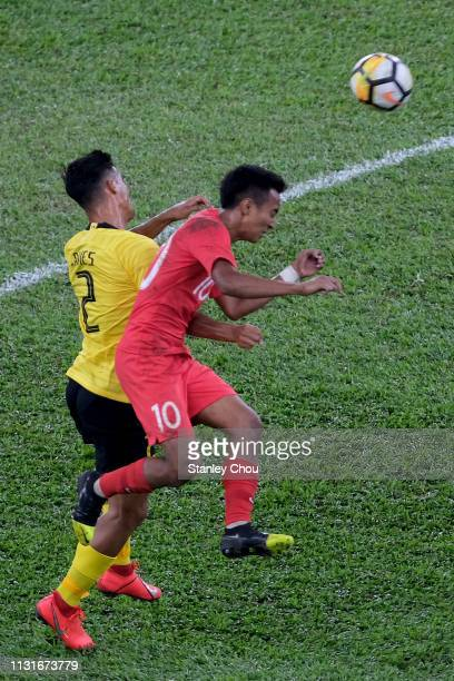 Matthew Thomas of Malaysia battles Muhammad Faris of Singapore during the Airmarine Cup match between Malaysia and Singapore at Bukit Jalil National...