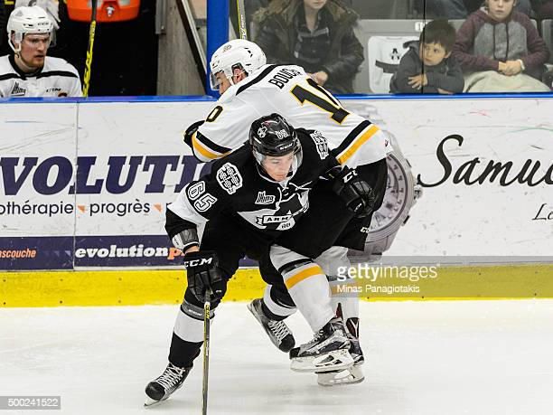 Matthew Thorpe of the BlainvilleBoisbriand Armada checks Dillon Boucher of the Cape Breton Screaming Eagles during the QMJHL game at the Centre...
