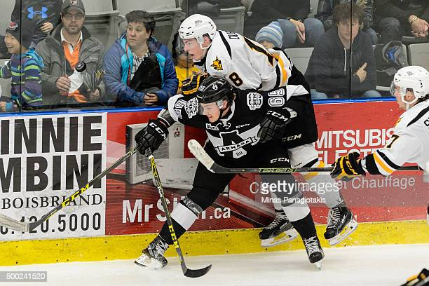 Matthew Thorpe of the BlainvilleBoisbriand Armada checks Phelix Martineau of the Cape Breton Screaming Eagles during the QMJHL game at the Centre...