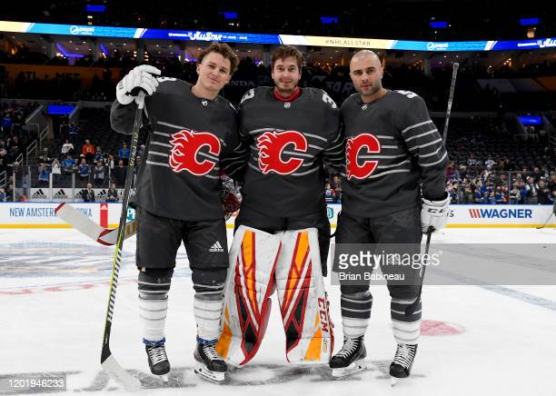 Matthew Tkachuk David Rittich and Mark Giordano of the Calgary Flames pose for a photo prior to the 2020 NHL AllStar Game at the Enterprise Center on...