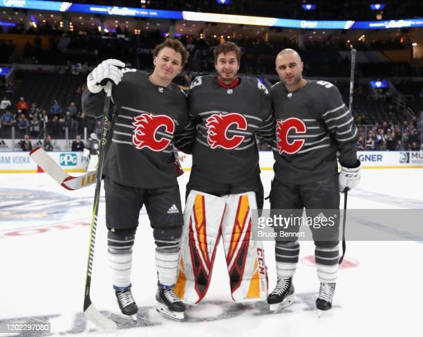 Matthew Tkachuk David Rittich and Mark Giordano of the Calgary Flames pose for a photo prior to the 2020 Honda NHL AllStar Game at Enterprise Center...