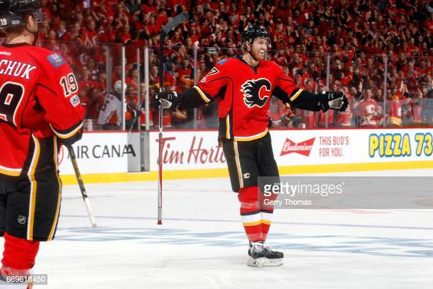 Matthew Tkachuk Dougie Hamilton and teammates of the Calgary Flames celebrate a goal against the Anaheim Ducks during Game One of the Western...
