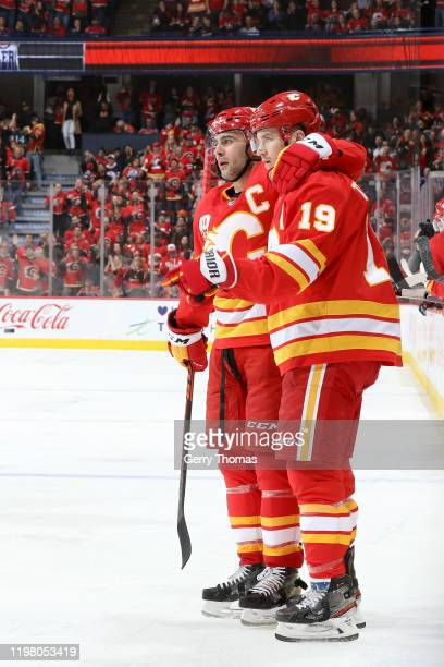 Matthew Tkachuk Mark Giordano # and teammates of the Calgary Flames celebrates a goal against the Edmonton Oilers at Scotiabank Saddledome on...