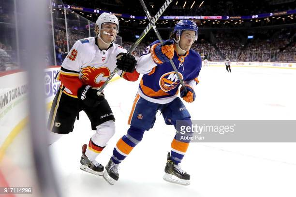Matthew Tkachuk of the Calgary Flames and Mathew Barzal of the New York Islanders chase the puck in the first period during their game at Barclays...