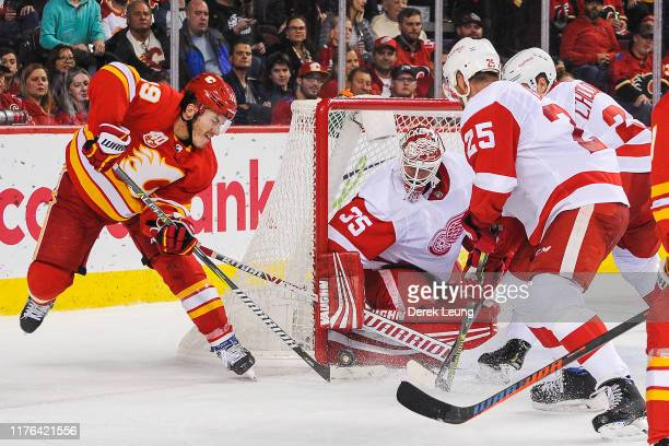 Matthew Tkachuk of the Calgary Flames attempts a wrap-around shot on Jimmy Howard of the Detroit Red Wings at Scotiabank Saddledome on October 17,...