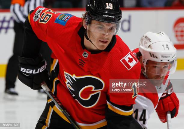Matthew Tkachuk of the Calgary Flames battles against Justin Williams of the Carolina Hurricanes at Scotiabank Saddledome on October 19 2017 in...