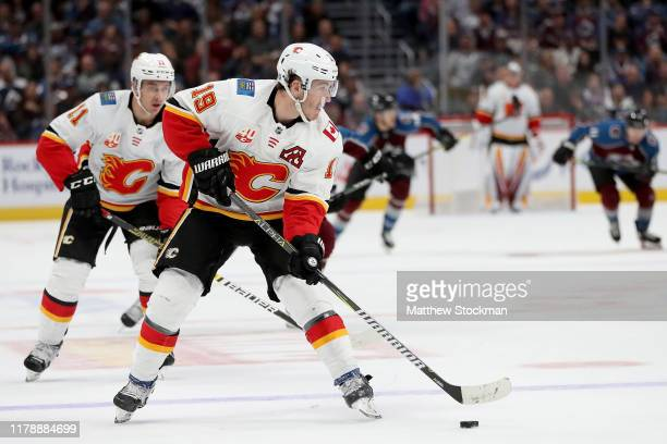 Matthew Tkachuk of the Calgary Flames brings the puck down the ice against the Colorado Avalanche in the third period at the Pepsi Center on October...
