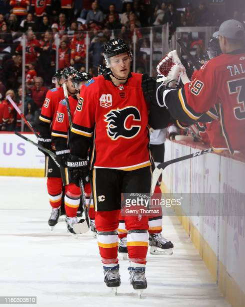 Matthew Tkachuk of the Calgary Flames celebrates a goal against the Arizona Coyotes with the bench on November 5 2019 at the Scotiabank Saddledome in...