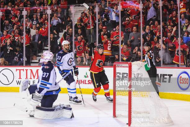 Matthew Tkachuk of the Calgary Flames celebrates after scoring against the Winnipeg Jets during an NHL game at Scotiabank Saddledome on November 21...