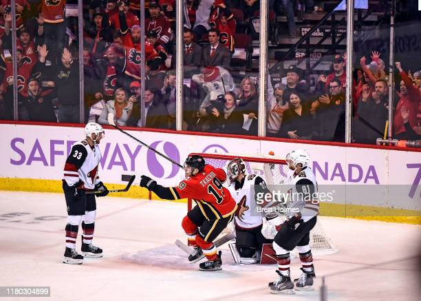 Matthew Tkachuk of the Calgary Flames celebrates after scoring the overtime winning goal against the Arizona Coyotes on November 5 2019 at the...