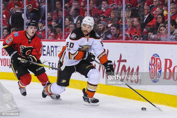 Matthew Tkachuk of the Calgary Flames chases Antoine Vermette of the Anaheim Ducks in Game Four of the Western Conference First Round during the 2017...