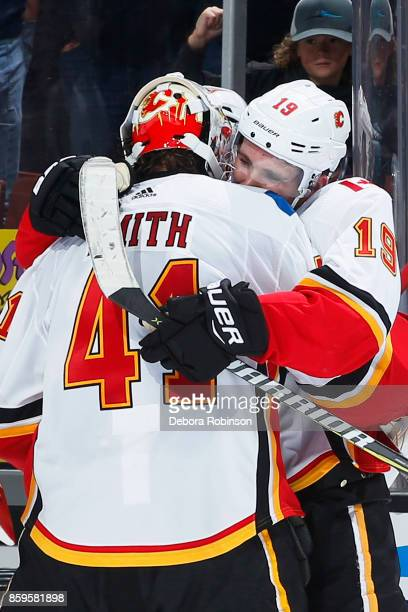 Matthew Tkachuk of the Calgary Flames congratulates Mike Smith after a shutout win against the Anaheim Ducks on October 9 2017 at Honda Center in...