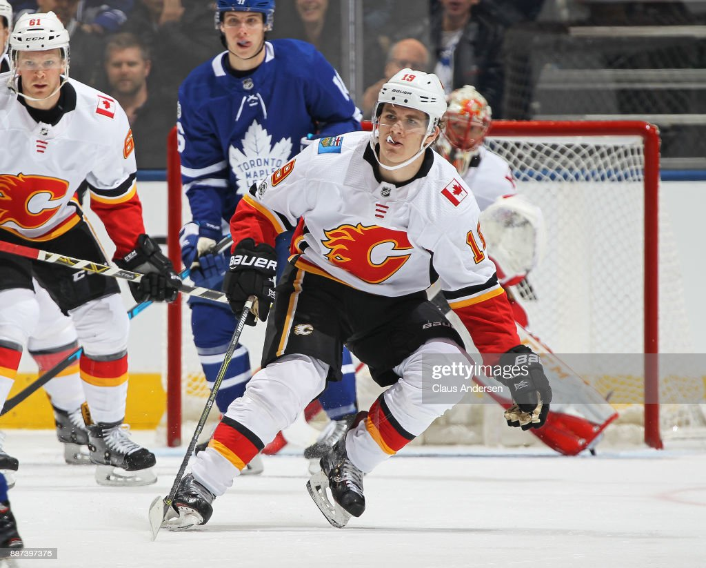 Matthew Tkachuk #19 of the Calgary Flames defends against the Toronto Maple Leafs during an NHL game at the Air Canada Centre on December 6, 2017 in Toronto, Ontario, Canada. The Maple Leafs defeated the Flames 2-1 in an overtime shoot-out.