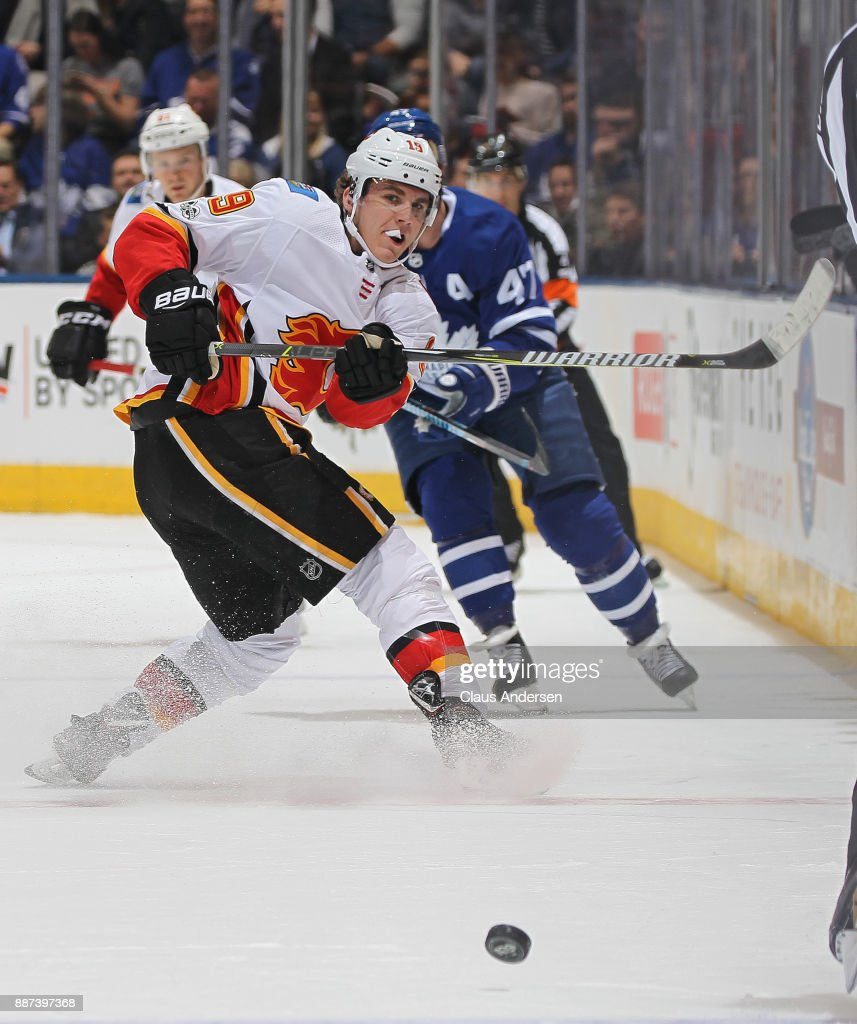 Matthew Tkachuk #19 of the Calgary Flames fires a puck in against the Toronto Maple Leafs during an NHL game at the Air Canada Centre on December 6, 2017 in Toronto, Ontario, Canada. The Maple Leafs defeated the Flames 2-1 in an overtime shoot-out.