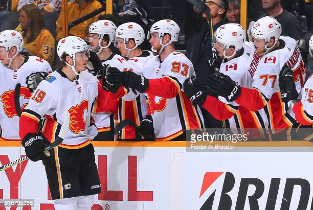 Matthew Tkachuk of the Calgary Flames is congratulated by teammates Sam Bennett and Mark Jankowski after scoring a goal against the Nashville...