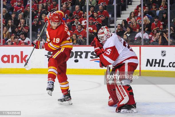 Matthew Tkachuk of the Calgary Flames looks for a rebound against Jimmy Howard of the Detroit Red Wings at Scotiabank Saddledome on October 17 2019...