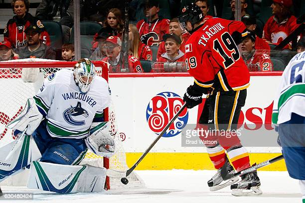 Matthew Tkachuk of the Calgary Flames shoots the puck on Jacob Markstrom of the Vancouver Canucks during an NHL game on December 23 2016 at the...