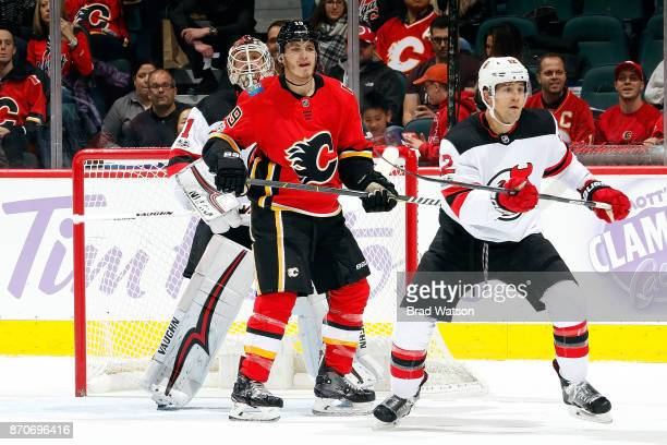 Matthew Tkachuk of the Calgary Flames skates against Ben Lovejoy of the New Jersey Devils during an NHL game on November 5 2017 at the Scotiabank...