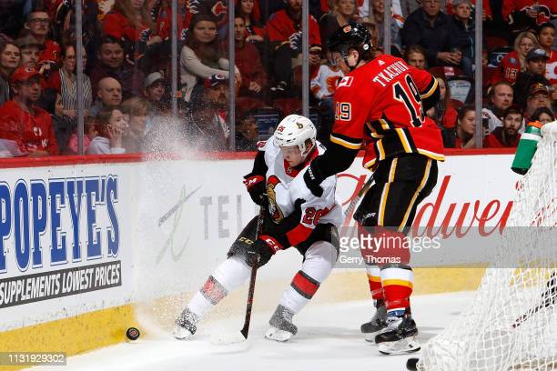 Matthew Tkachuk of the Calgary Flames skates against Erik Brannstrom of the Ottawa Senators during an NHL game on March 21 2019 at the Scotiabank...