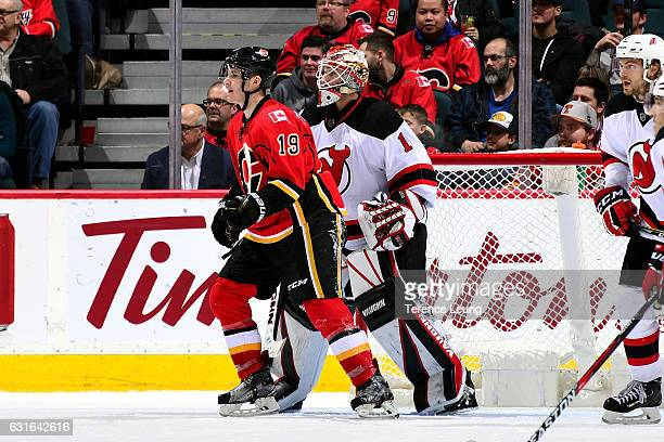 Matthew Tkachuk of the Calgary Flames skates against Keith Kinkaid of the New Jersey Devils during an NHL game on January 13 2017 at the Scotiabank...