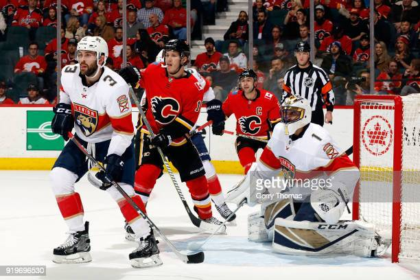Matthew Tkachuk of the Calgary Flames skates against Roberto Luongo and Keith Yandle of the Florida Panthers during an NHL game on February 17 2018...