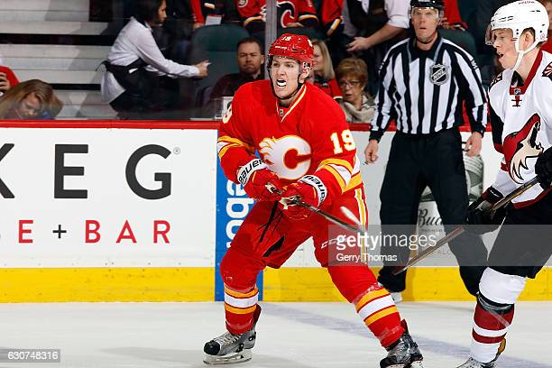 Matthew Tkachuk of the Calgary Flames skates against the Arizona Coyotes during an NHL game on December 31 2016 at the Scotiabank Saddledome in...