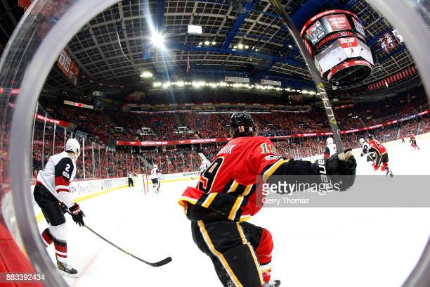 Matthew Tkachuk of the Calgary Flames skates against the Arizona Coyotes during an NHL game on November 30 2017 at the Scotiabank Saddledome in...