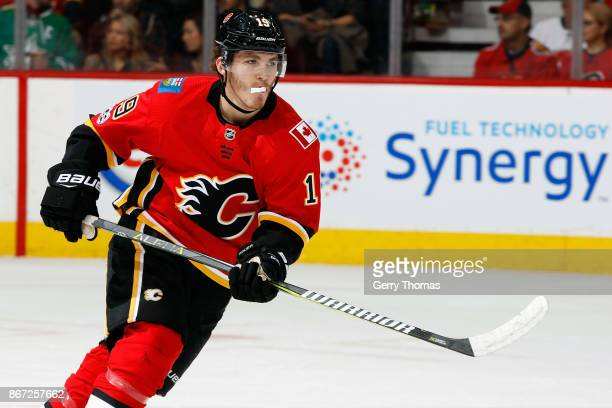 Matthew Tkachuk of the Calgary Flames skates against the Dallas Stars during an NHL game on October 27 2017 at the Scotiabank Saddledome in Calgary...