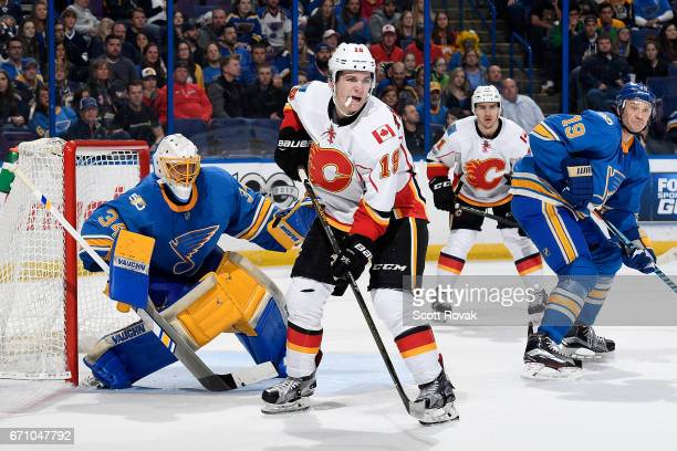 Matthew Tkachuk of the Calgary Flames skates in front of Jake Allen of the St Louis Blues on March 25 2017 at Scottrade Center in St Louis Missouri