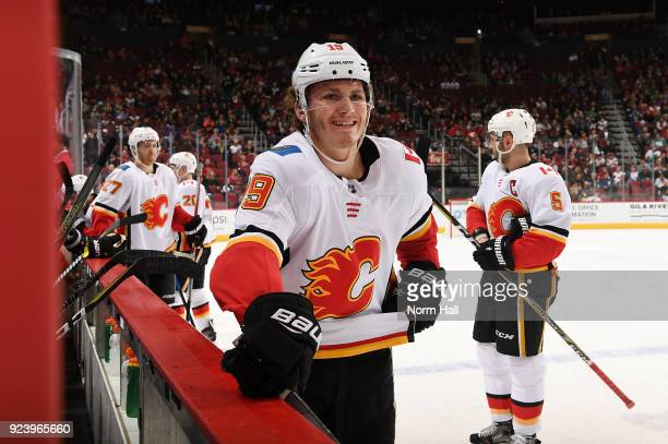 Matthew Tkachuk of the Calgary Flames smiles at the Arizona Coyotes bench during a stop in play at Gila River Arena on February 22 2018 in Glendale...