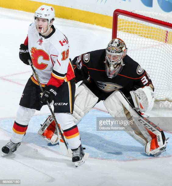 Matthew Tkachuk of the Calgary Flames stands in the crease as goalie John Gibson of the Anaheim Ducks tends net during the second period of the game...