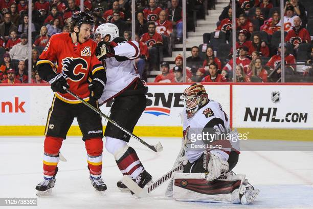 Matthew Tkachuk of the Calgary Flames takes a shot on Calvin Pickard of the Arizona Coyotes during an NHL game at Scotiabank Saddledome on February...