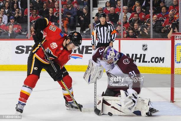 Matthew Tkachuk of the Calgary Flames takes a shot on Philipp Grubauer of the Colorado Avalanche during an NHL game at Scotiabank Saddledome on...