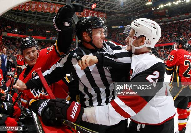 Matthew Tkachuk of the Calgary Flames trades shots against Oliver EkmanLarsson of the Arizona Coyotes at Scotiabank Saddledome on March 6 2020 in...