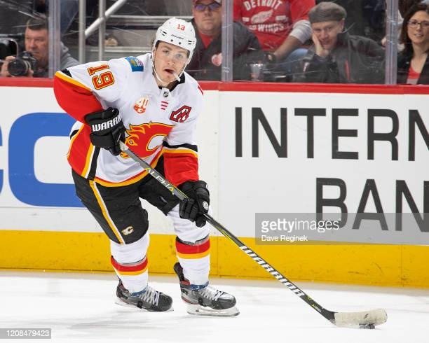 Matthew Tkachuk of the Calgary Flames turns up ice with the puck against the Detroit Red Wings during an NHL game at Little Caesars Arena on February...
