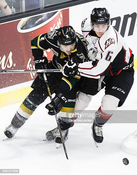 Matthew Tkachuk of the London Knights battles for puck possession with Philippe Myers of the Rouyn-Noranda Huskies during the Memorial Cup Final on...