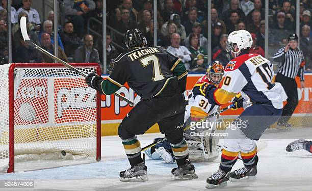 Matthew Tkachuk of the London Knights celebrates a goal by teammate Christian Dvorak against the Erie Otters during Game Three of the OHL Western...