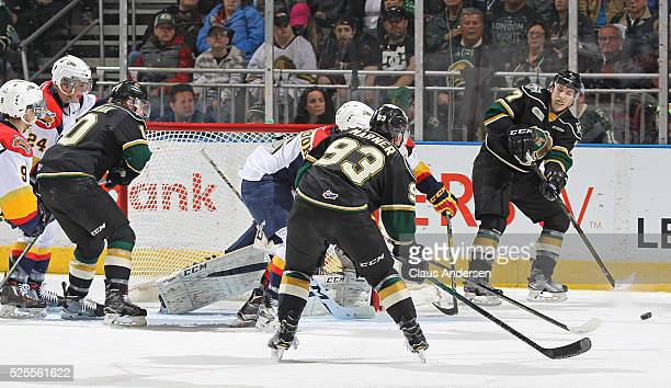 Matthew Tkachuk of the London Knights looks to make a pass to teammate Mitchell Marner during action against the Erie Otters in game four of the OHL...