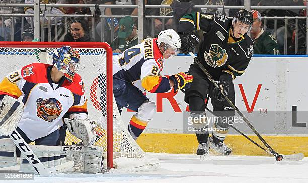 Matthew Tkachuk of the London Knights makes a pass out front against Darren Raddysh of the Erie Otters during game four of the OHL Western Conference...
