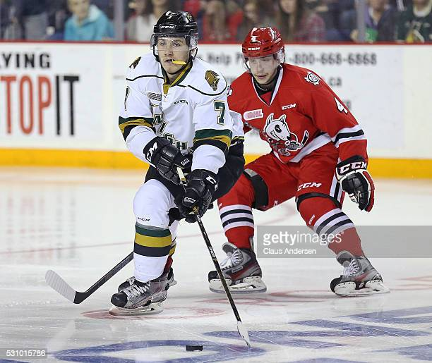 Matthew Tkachuk of the London Knights skates with the puck against Vince Dunn of the Niagara IceDogs during Game Four of the OHL Championship final...