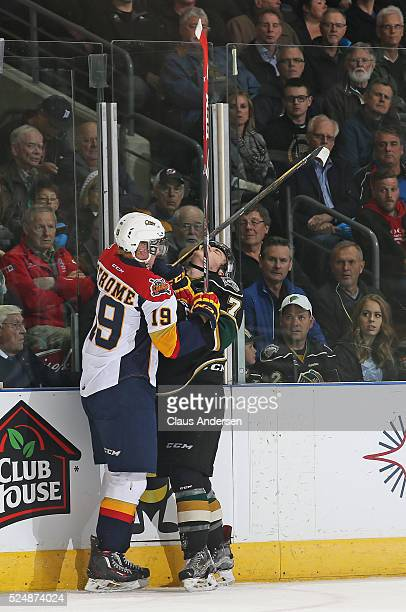 Matthew Tkachuk of the London Knights takes a stick in the face from Dylan Strome of the Erie Otters during Game Three of the OHL Western Conference...