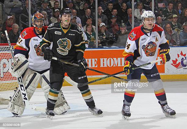 Matthew Tkachuk of the London Knights waits to tip a shot in front of Devin Williams of the Erie Otters during game Four of the OHL Western...