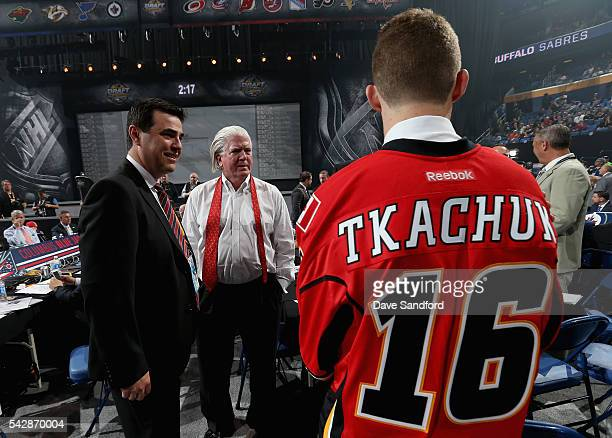 Matthew Tkachuk visits the Calgary Flames draft table after being selected sixth overall by the Calgary Flames during round one of the 2016 NHL Draft...