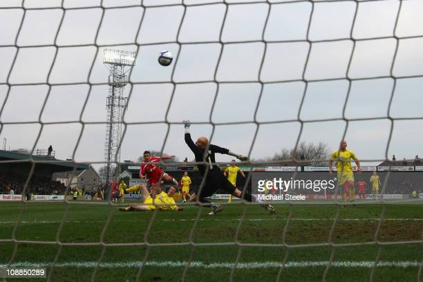 Matthew Tubbs of Crawley Town scores the opening goal during the FA Cup sponsored by EON 4th round match between Torquay United and Crawley Town at...