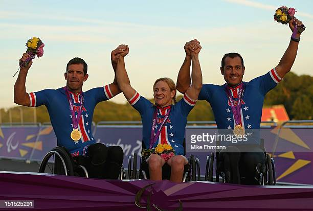 Matthew Updike, Marianna Davis, and Oscar Snachez of the United States celebrates winning the Mixed H 1-4 Cycling Team Relay on day 10 of the London...