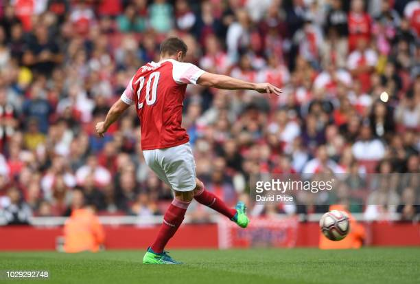 Matthew Upson of Arsenal scores a penalty in the shoot out during the match between Arsenal Legends and Real Madrid Legends at Emirates Stadium on...