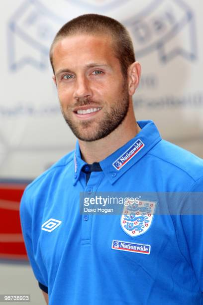 Matthew Upson of England tackles a giant football at Wembley Stadium the event was to mark the launch of The FA's England Football Day and encourage...