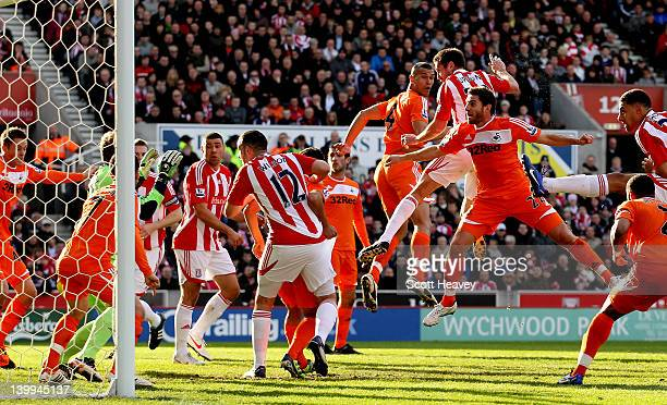 Matthew Upson of Stoke scores their first goal during the Barclays Premier League match between Stoke City and Swansea City at Britannia Stadium on...