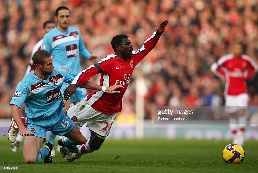 Matthew Upson of West Ham United challenges Emmanuel Eboue of Arsenal during the Barclays Premier League match between Arsenal and West Ham United at the Emirates Stadium on January 31, 2009 in London, England.